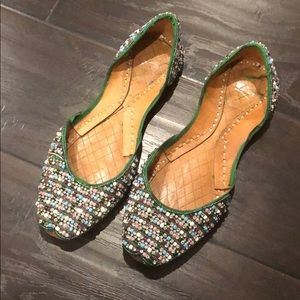 Green sparkly flats